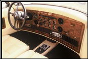 This 1987 Clenet Series II shows the luxurious interior features such as inlaid walnut burl and Waterford crystal ashtray.