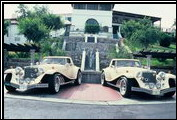 Clenet Series I #215 and #216 pose at the Wrigley Mansion on Catalina Island. This is the only set of twin Clenets ever built.